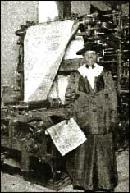 Flora Sengstacke, mother of Robert Abbott, with one of the first papers to come off its press in 1921