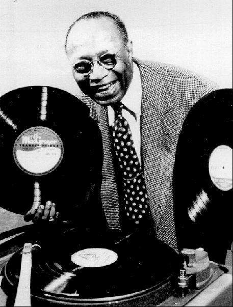Radio announcer Jack L. Cooper