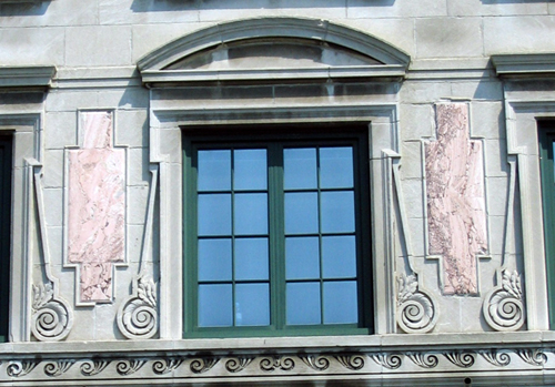 Arched pediment at window head